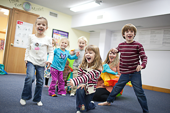 Children laughing at the end of the Kindermusik class